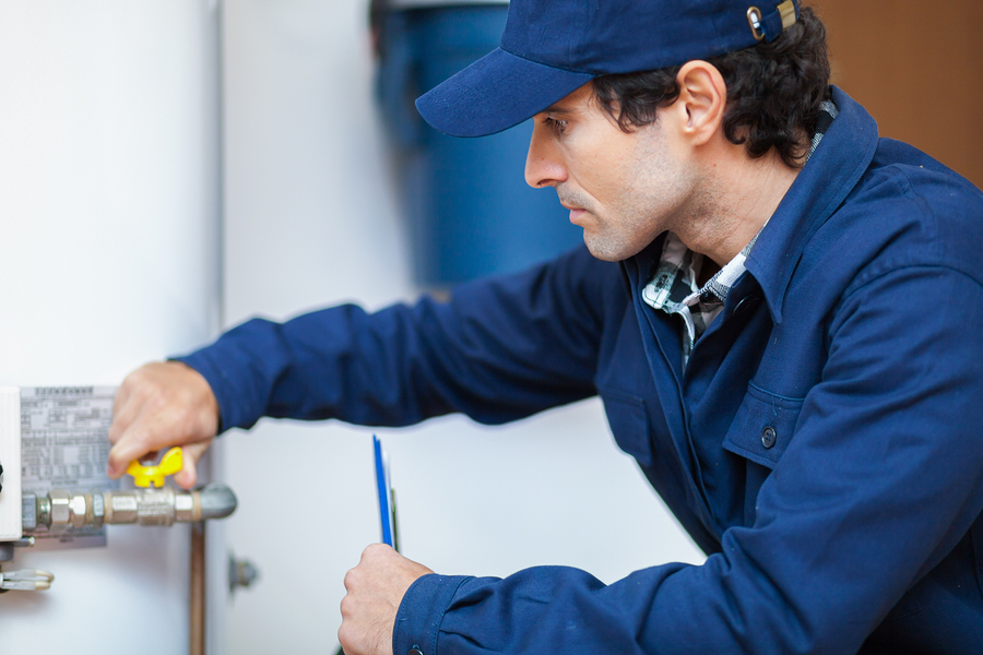 Plumber performing Water Heater Installation and Repair in Perry Hall, MD